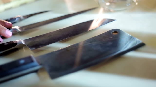 female chef hand taking knife from set at restaurant kitchen, cooking tools - lama oggetto creato dall'uomo video stock e b–roll