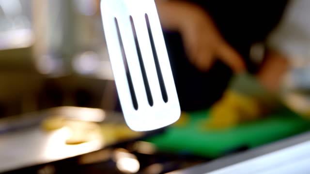 female chef working in kitchen 4k - szpatułka przybór do gotowania filmów i materiałów b-roll