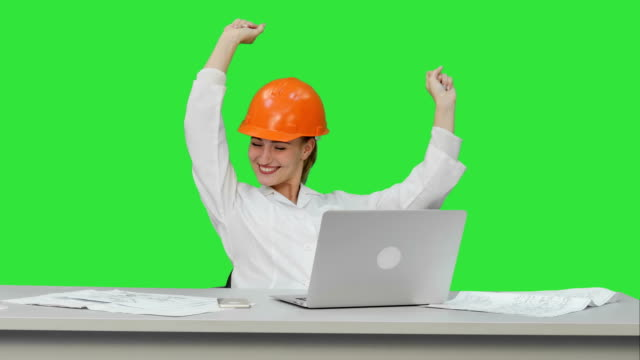 Female chief engineer celebrate a successful finish of project, smiling on a Green Screen, Chroma Key video