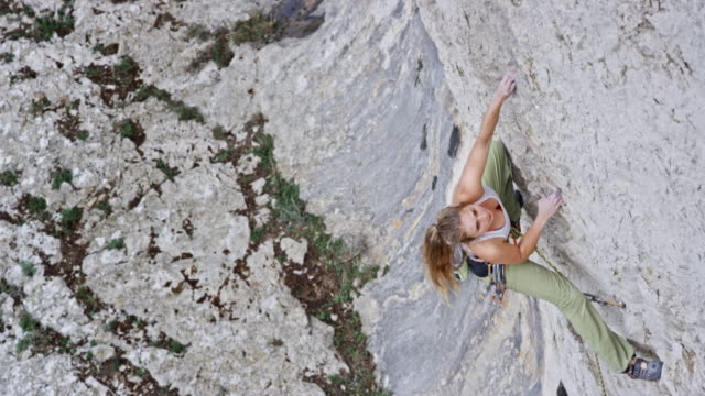 female climber ascending the cliff - cliffs stock videos & royalty-free footage