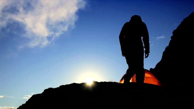 Female Climber in Silhouette Watching the Sun Rise video