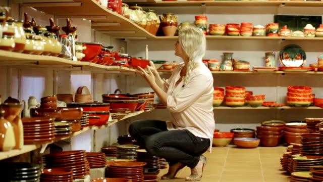 female customer picking crockery video