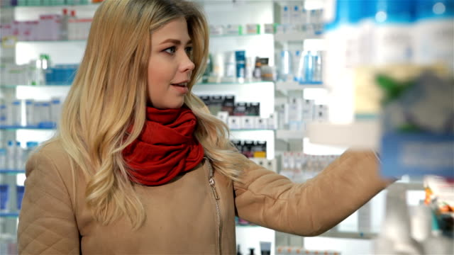 Female customer shows her thumb up at the drugstore video