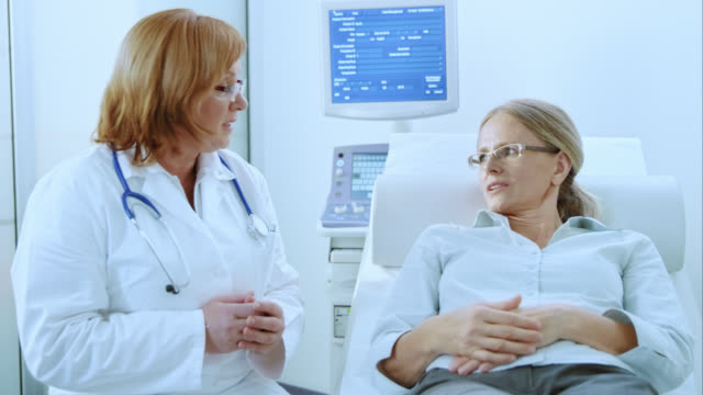 Female doctor and patient in examination room having a discussion video
