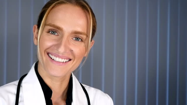 Female doctor and scientist smiling video