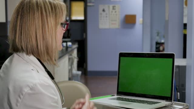Female doctor consulting with a patient via a video chat over the internet