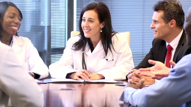 Female Doctor Leads a Meeting with Professionals - CU video