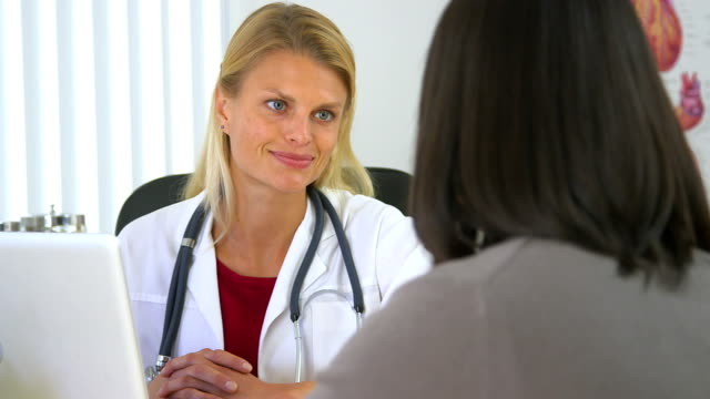 Female doctor listening to Japanese patient talking video