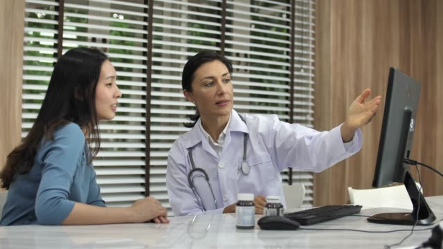 Female Doctor Meets With Asian Patient In Office Female Doctor Meets With Asian Patient In Office good news stock videos & royalty-free footage