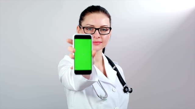 Female doctor showing phone screen video