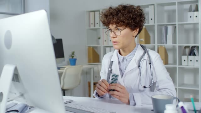 female doctor talking to patient on video call - telemedicine stock videos & royalty-free footage