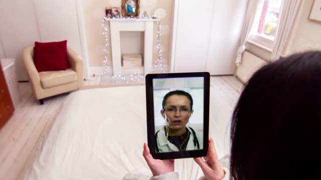 female doctor telemedicine consultation on tablet device - telemedicine stock videos & royalty-free footage