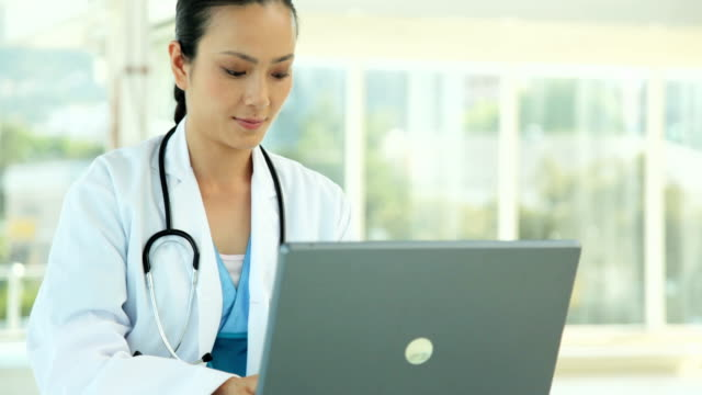 Female Doctor with a Laptop video