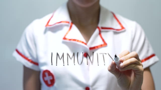 IMMUNITY, Female doctor writing on transparent screen video