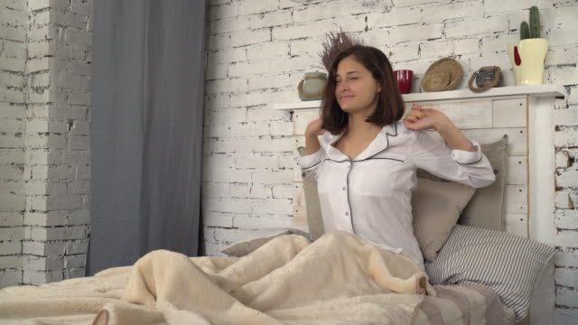 Female dressed in pajamas in room video