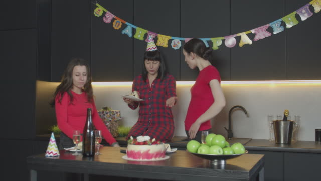 Female eating cake at her birthday party alone