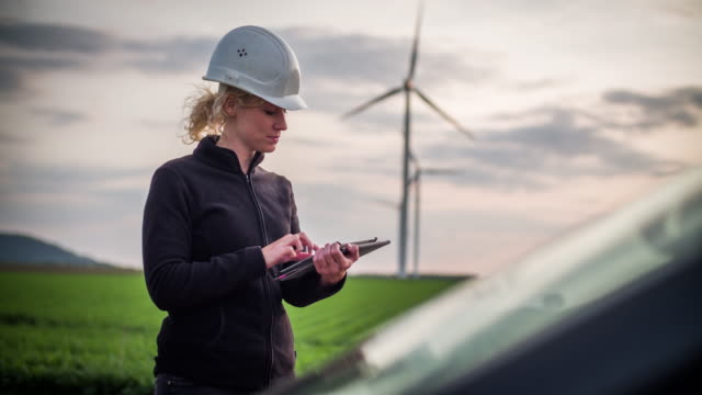Female engineer in front of wind turbines - Women in STEM video