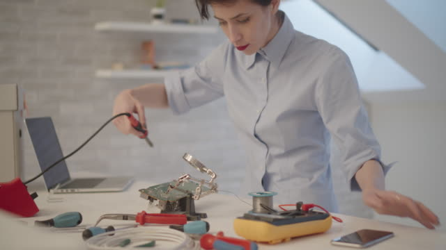 4K: Female Engineer Soldering a Circuit Board In Her Office. video