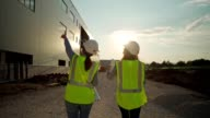 istock Female engineers overseeing construction site 1259830728