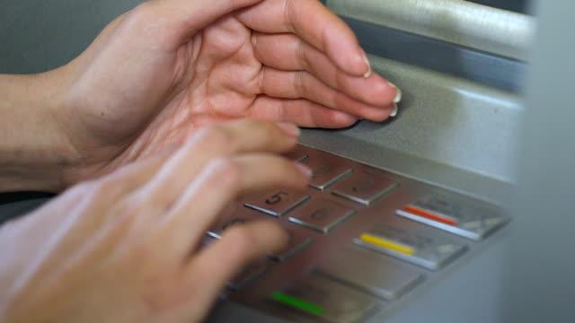 vídeos de stock, filmes e b-roll de inserir o seu código pin feminino e esconder o teclado de caixa automático - pin