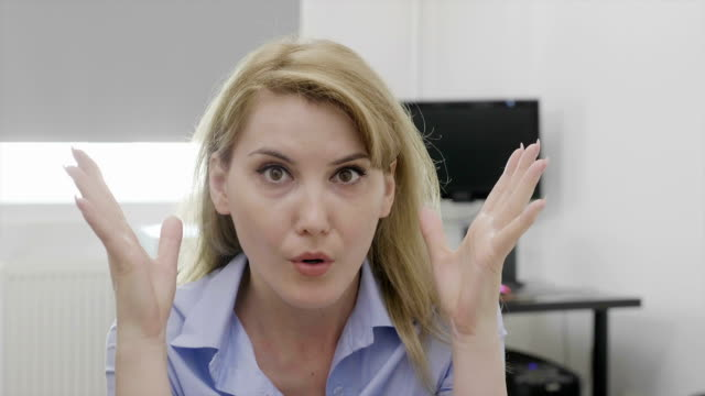 Female entrepreneur doing mind blown shocked reaction and gesture