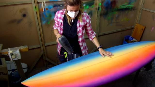 Female entrepreneur making custom surfboards