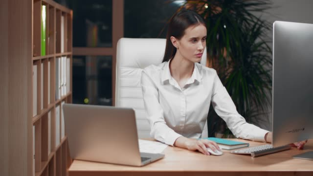 female entrepreneur with headache sitting at desk - treedeo stock videos and b-roll footage
