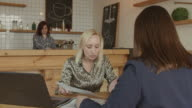 istock Female entrepreneurs arguing at meeting in cafe 1140540810