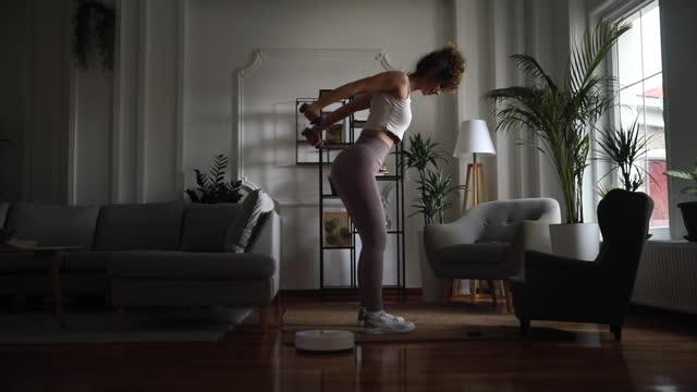 Female exercise in living room video