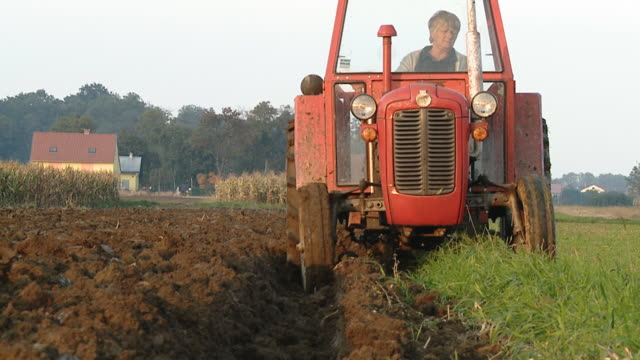 HD DOLLY: Female Farmer Plowing The Soil video