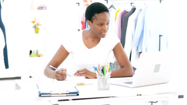 HD: Female Fashion Designer Working At Laptop. video