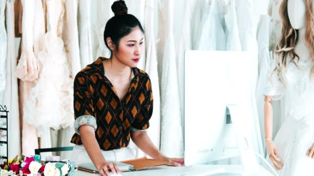 Female Fashion Designer Working With Computer Desktop