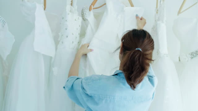 Female Fashion Designer Working With Wedding Dresses video