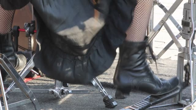 Female feet on drum pedals video