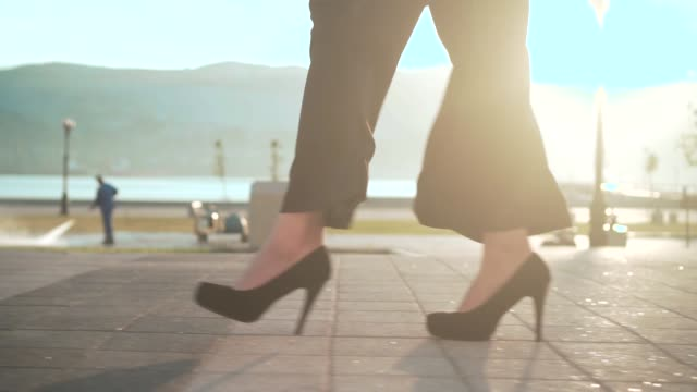Female feet walking through the downtown. Businesswoman wearing shoes with heels. Stylish woman walking. Female feet walking through the downtown. Businesswoman wearing shoes with heels. Stylish woman walking in city center. stepping stock videos & royalty-free footage