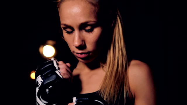 A female fighter portrait in dark still shot. video