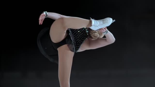 SLO MO TU Female figure skater in a catchfoot spin video