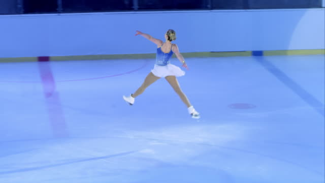 SLO MO TS Female figure skater performing a jump video