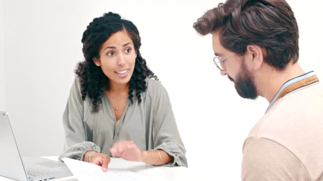 Female financial planner discusses investments with client