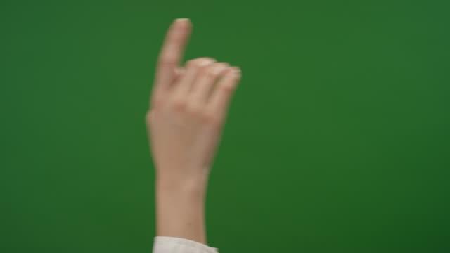 female finger making tap gestures on green screen - spingere video stock e b–roll