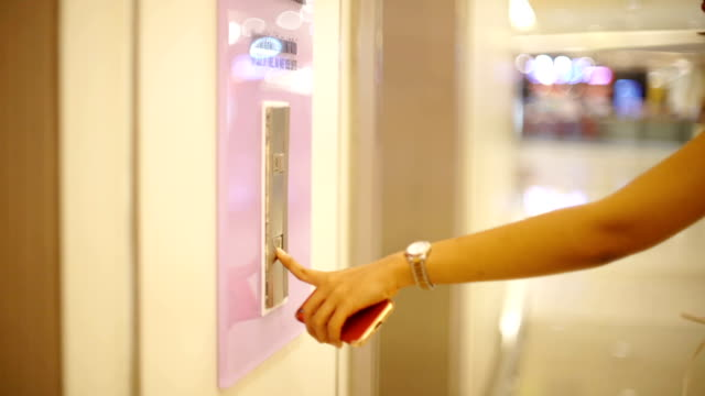 Female finger pressing button of elevator in shopping mall video