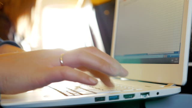 female fingers typing on the keyboard - key ring stock videos & royalty-free footage