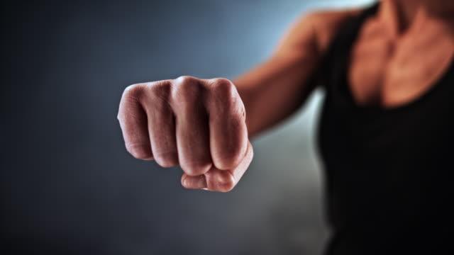 slo mo ld female fist pulling back - pugno video stock e b–roll