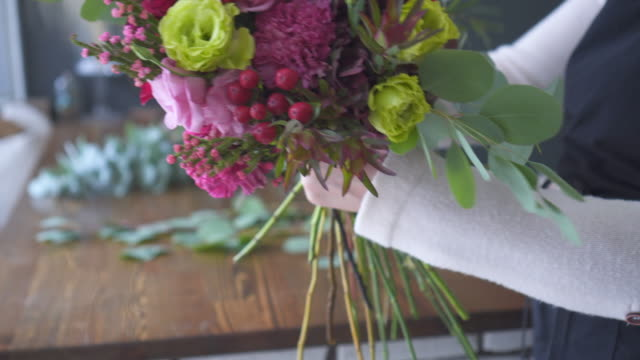 Female florist making bouquet