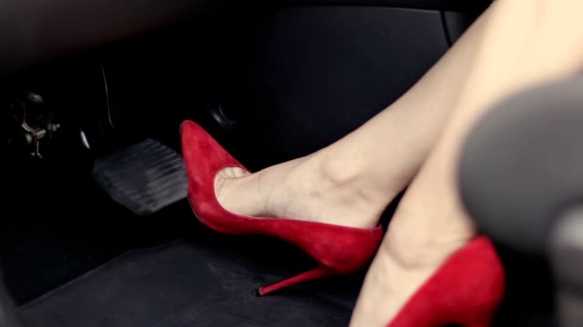 Female foot in high heels pushing car brake pedal video