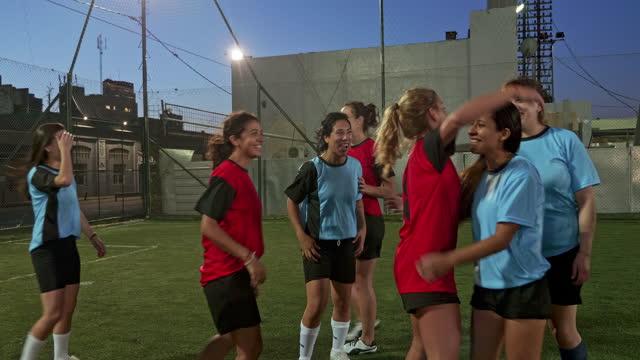 Female Footballers saluting after a good football match