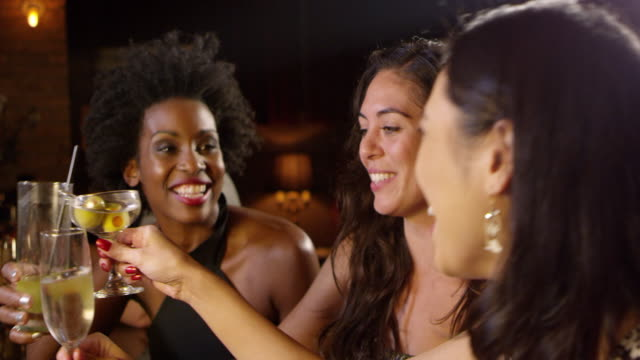 female friends enjoy night out at cocktail bar shot on r3d - bachelorette party stock videos and b-roll footage