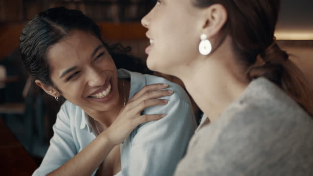female friends enjoying at a coffee shop - amicizia tra donne video stock e b–roll
