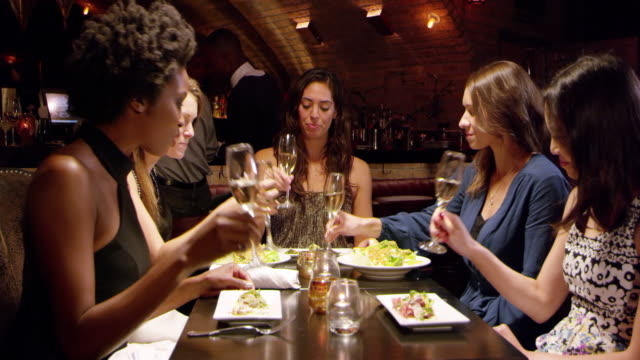Female Friends Enjoying Meal In Restaurant Shot On R3D video