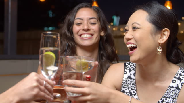 female friends enjoying night out at rooftop bar shot on r3d - bachelorette party stock videos and b-roll footage